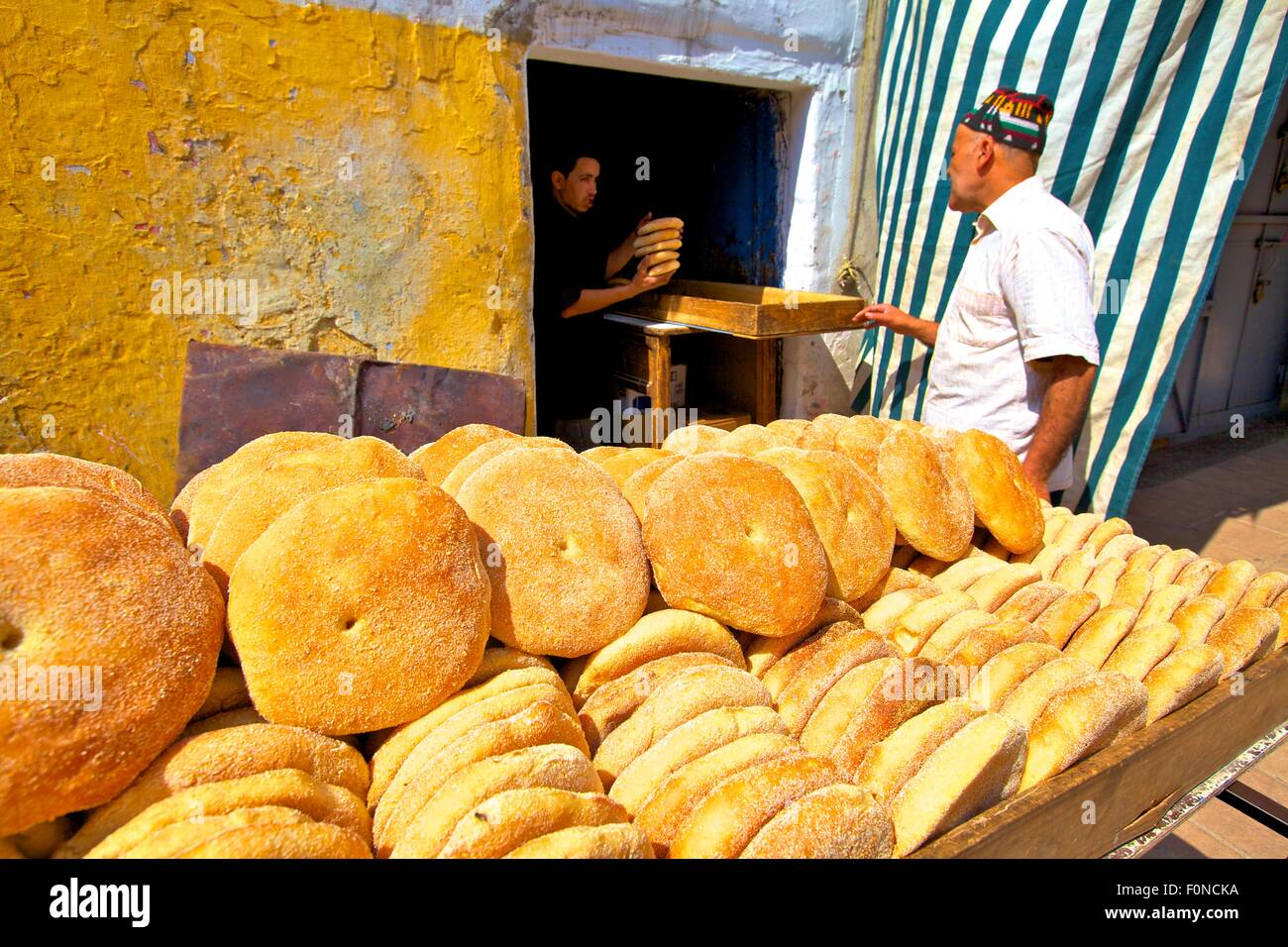 Baker with Freshly Baked Bread, Rabat, Morocco, North Africa - Stock Image