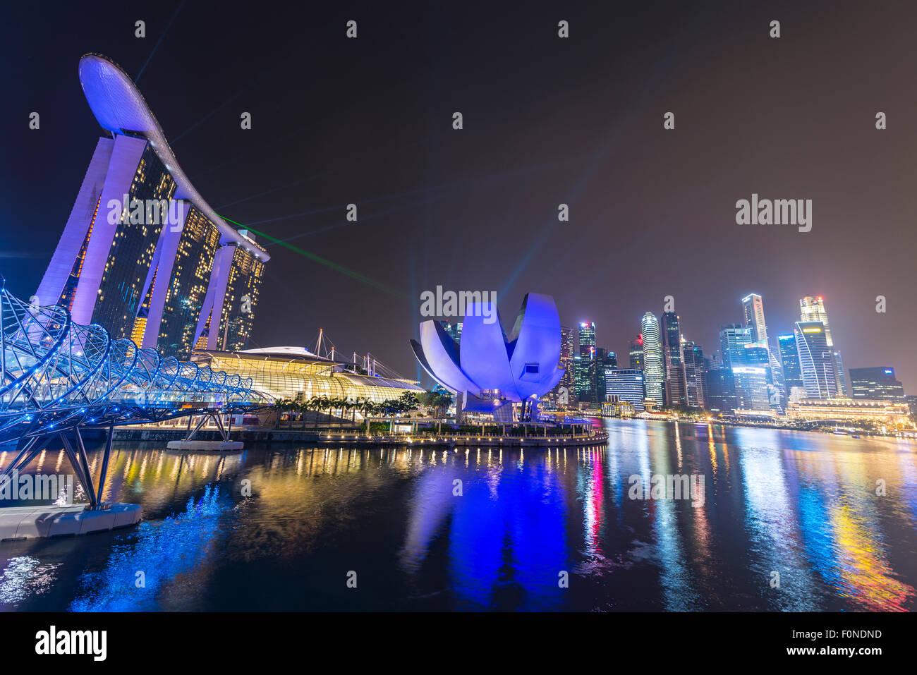 Light show, Millenium Bridge, Marina Bay Sands Hotel, Marina Bay, Museum of Science and Art, at night, Singapore - Stock Image