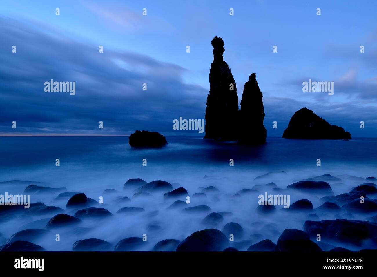 Volcanic rock formation Ilheus da Rib by the cliffs of Ribeira da Janela, Madeira, Portugal - Stock Image