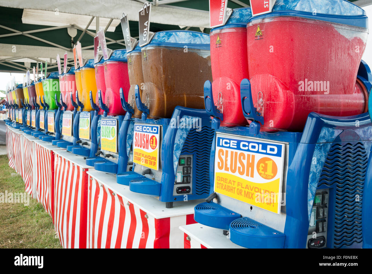 Slush drinks at a fair in the UK. Colourful iced frozen drinks. - Stock Image