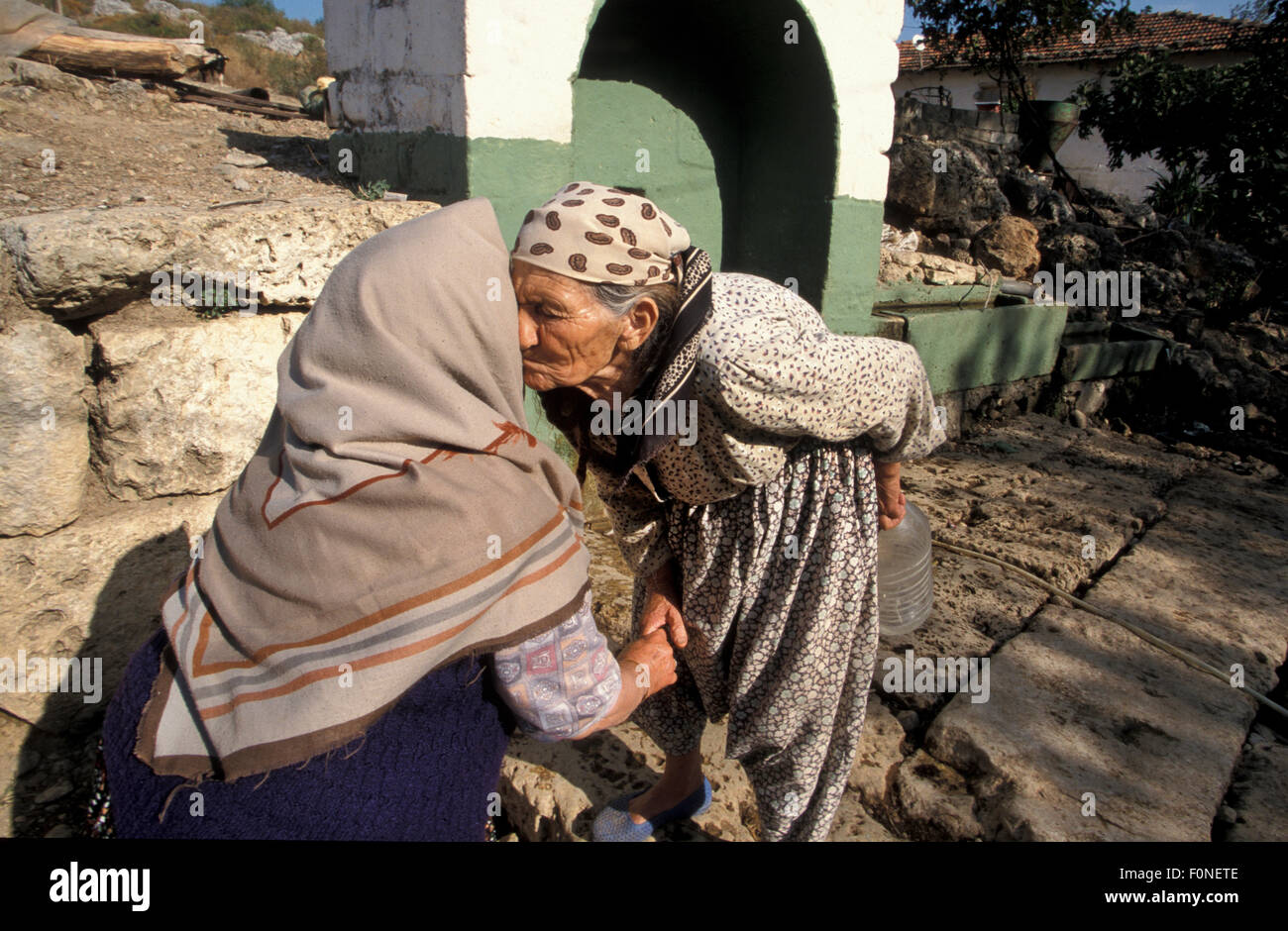 Elderly Turkish Woman Greeting Another Woman In Turkey Stock Photo