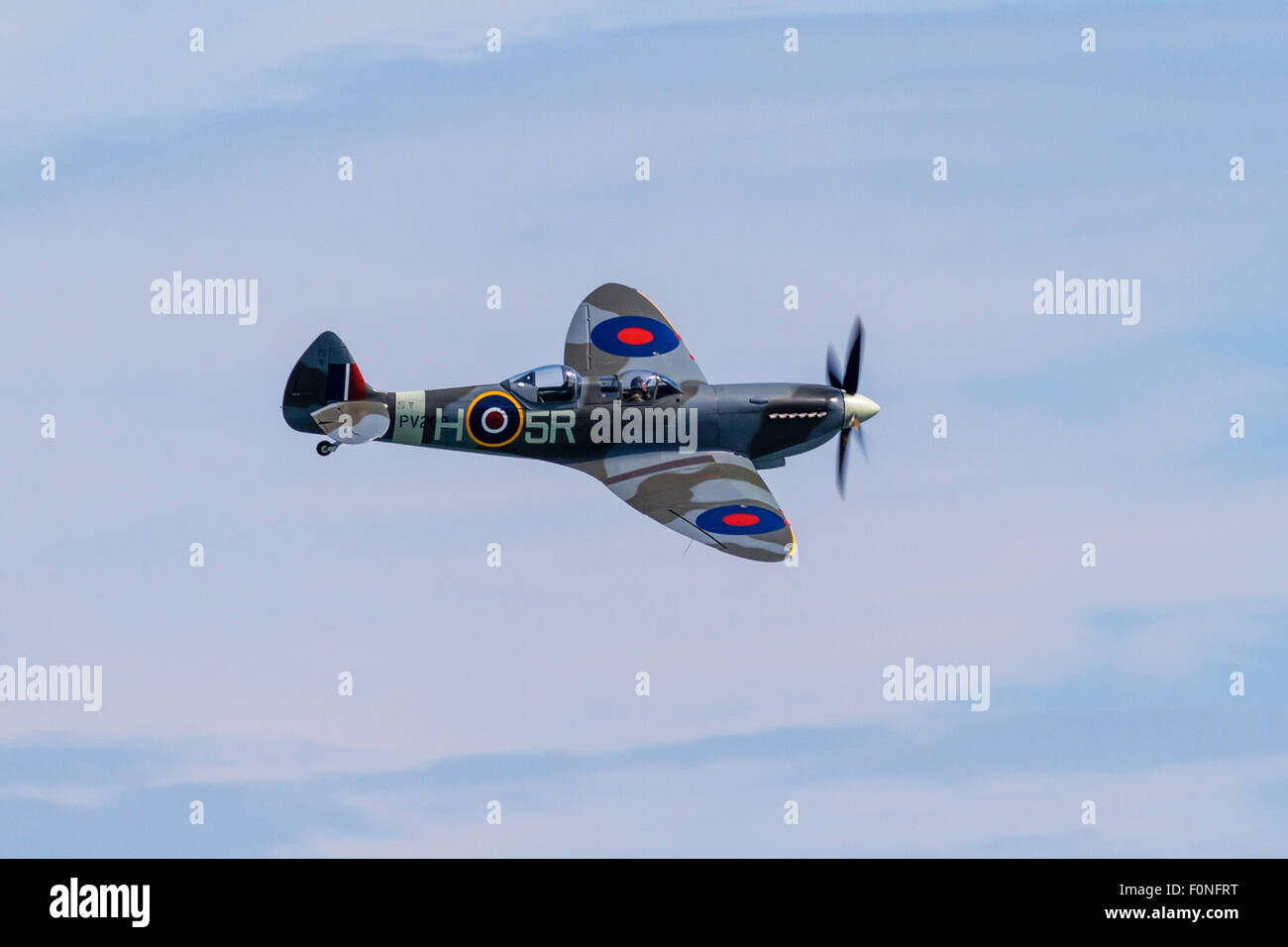 Spitfire flying over East Sussex at the Eastbourne Air Show, 14th August 2015, England, UK - Stock Image