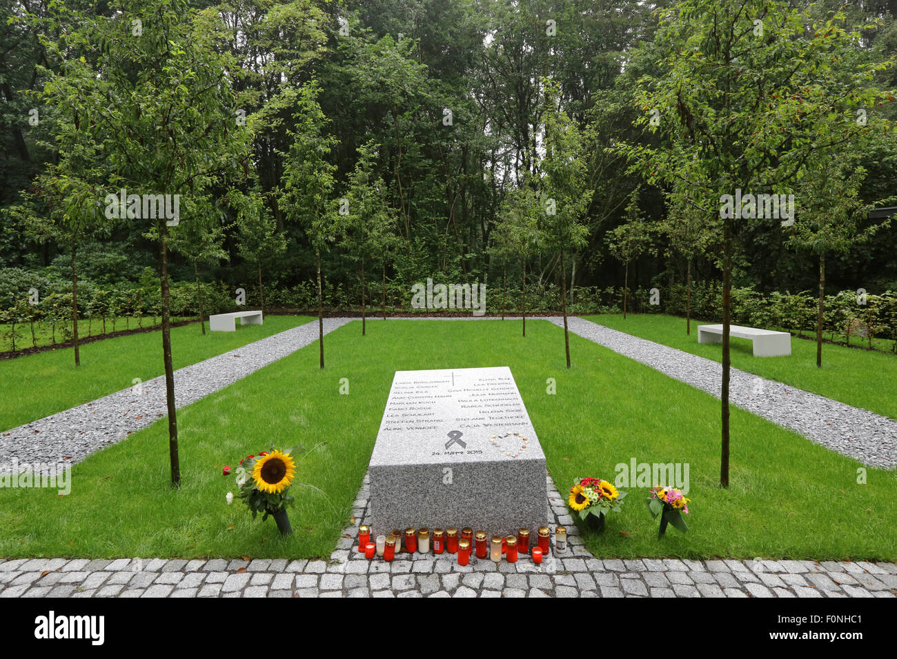 Memorial site of the forest cemetery of Haltern/Germany. The massive granite block commemorates the 16 students Stock Photo