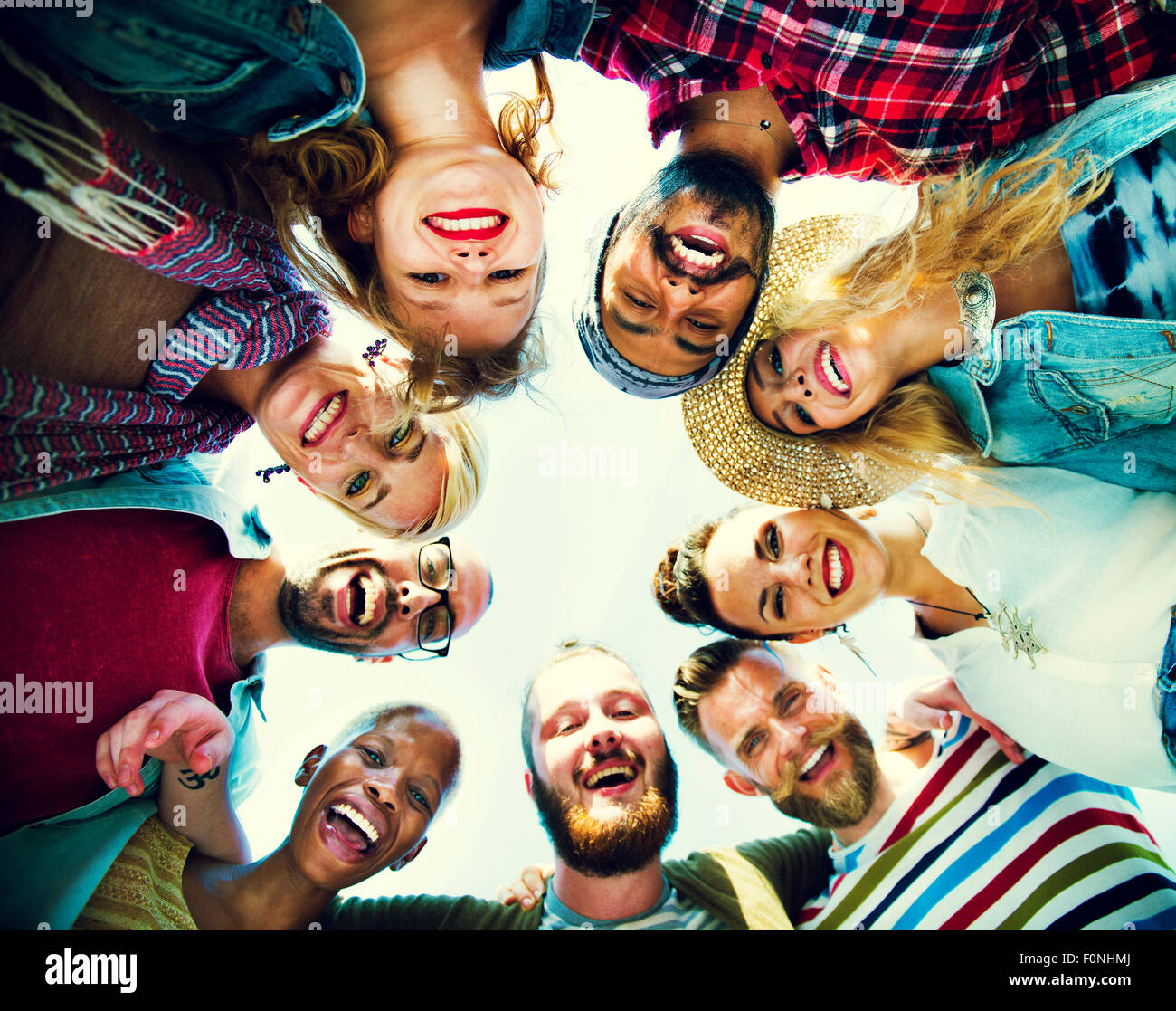 Friends Huddle Join Holiday Party Group Concept Stock Photo