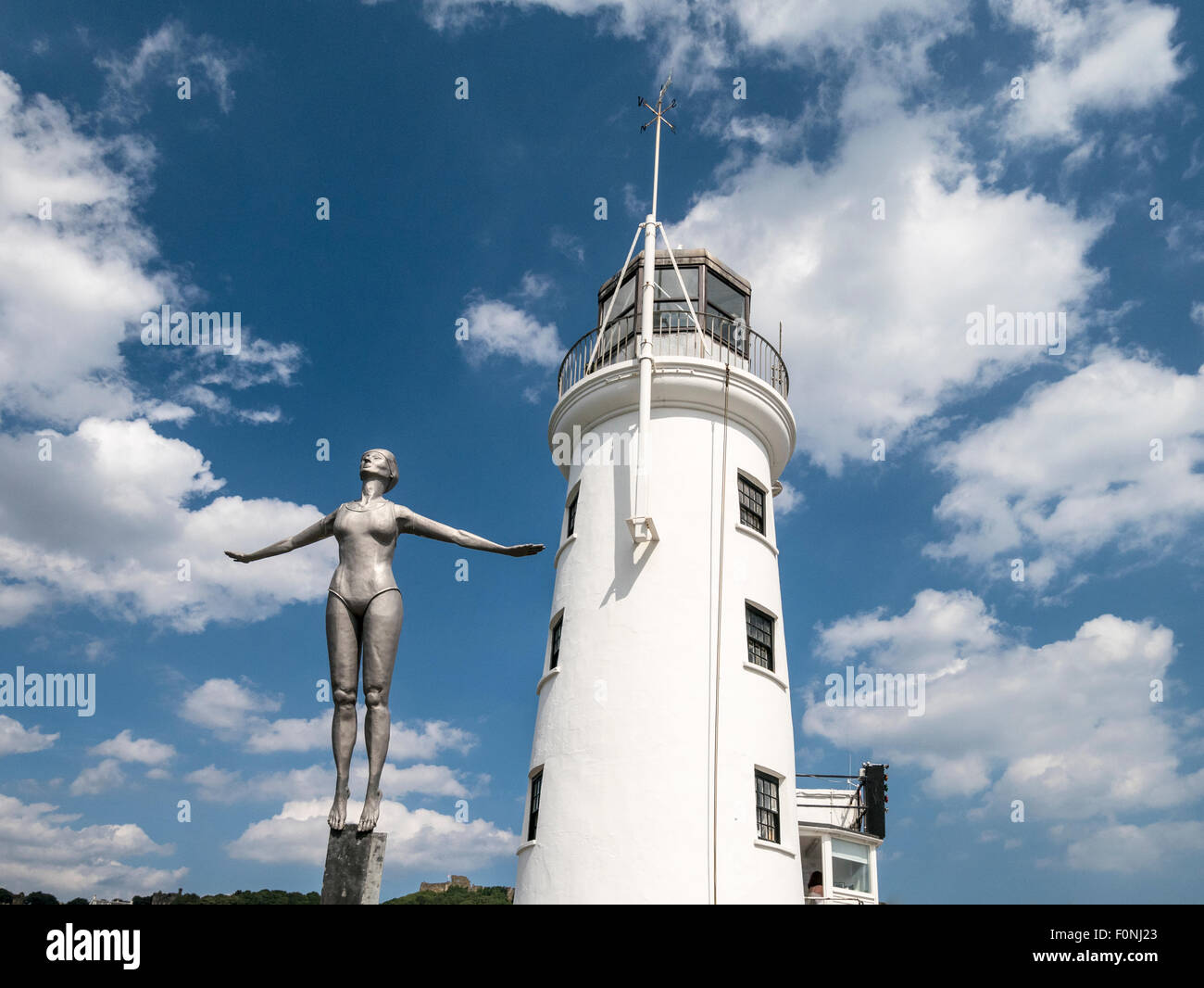 The Diving Belle sculpture 2007  and Lighthouse Scarborough Yorkshire UK - Stock Image