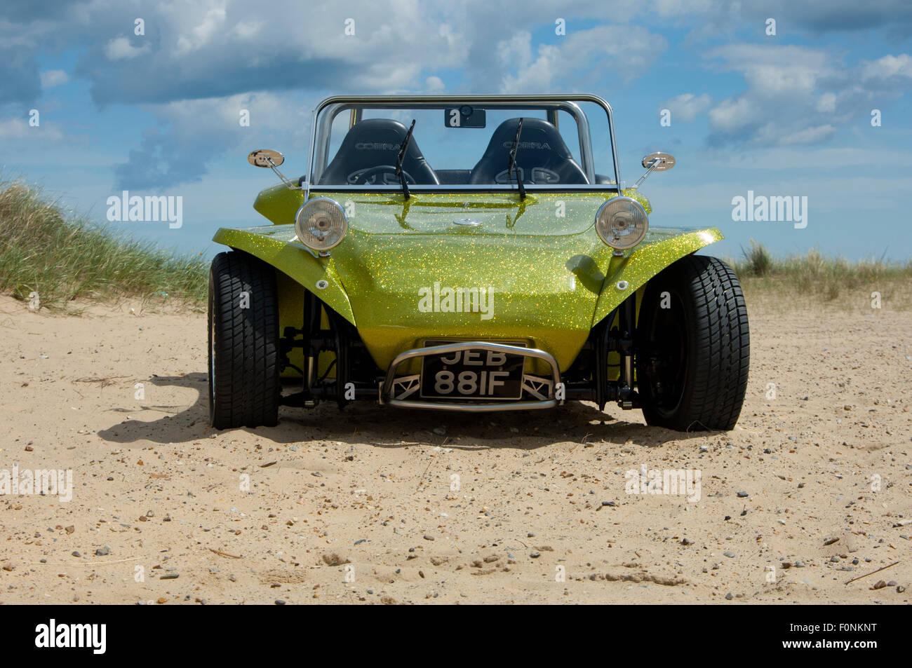 Beach buggy on a sandy beach  VW Beetle based dune buggy car Stock