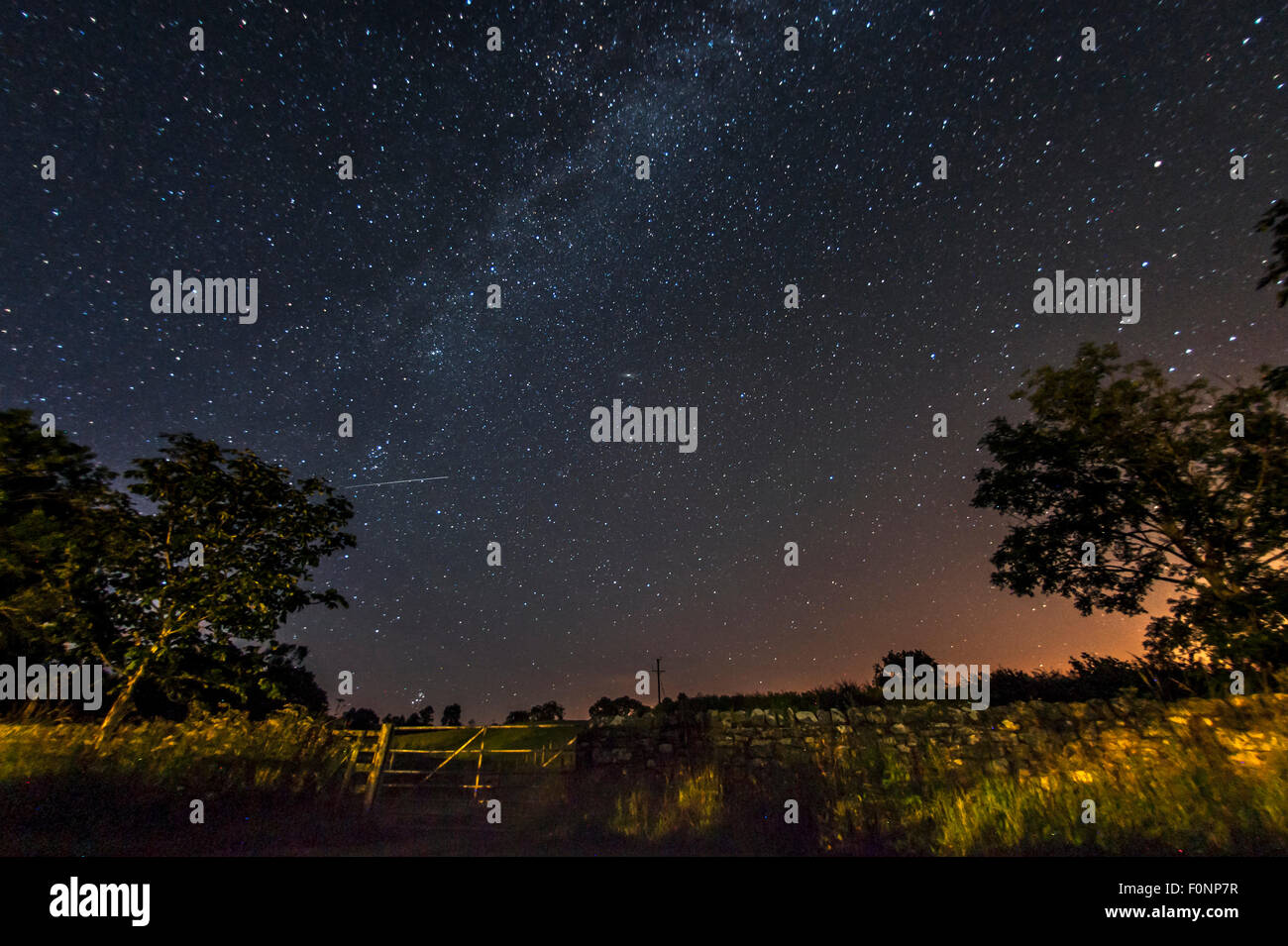 Milky Way in the countryside in Northumberland, England, Great Britain, UK - Stock Image