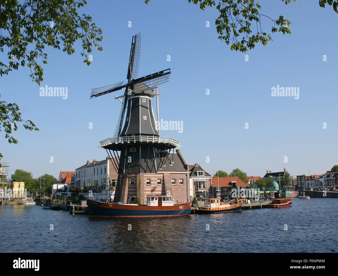 De Adriaan windmill in Haarlem, The Netherlands. Rebuilt in 2002. The original windmill dates from 1779. Seen from - Stock Image
