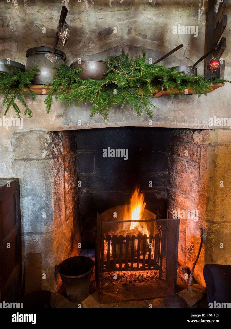 Medieval Christmas decorations over fireplace during Tudor ...