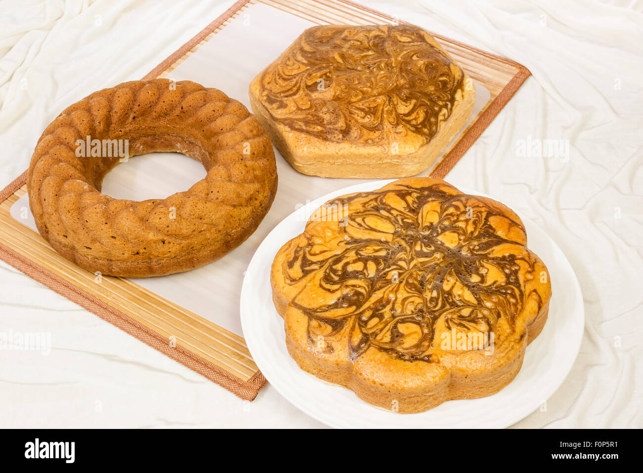 A top view of a couple of marble cakes and a pound bundt cake. - Stock Image