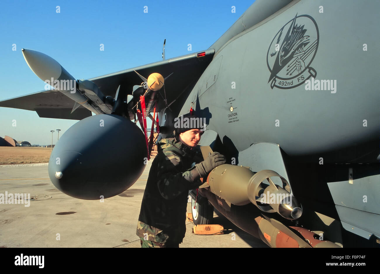 US Air Force, laser guided bombs are loaded on a AF 15 fighter-bomber in the US air base of Aviano (Pordenone, Italy) - Stock Image