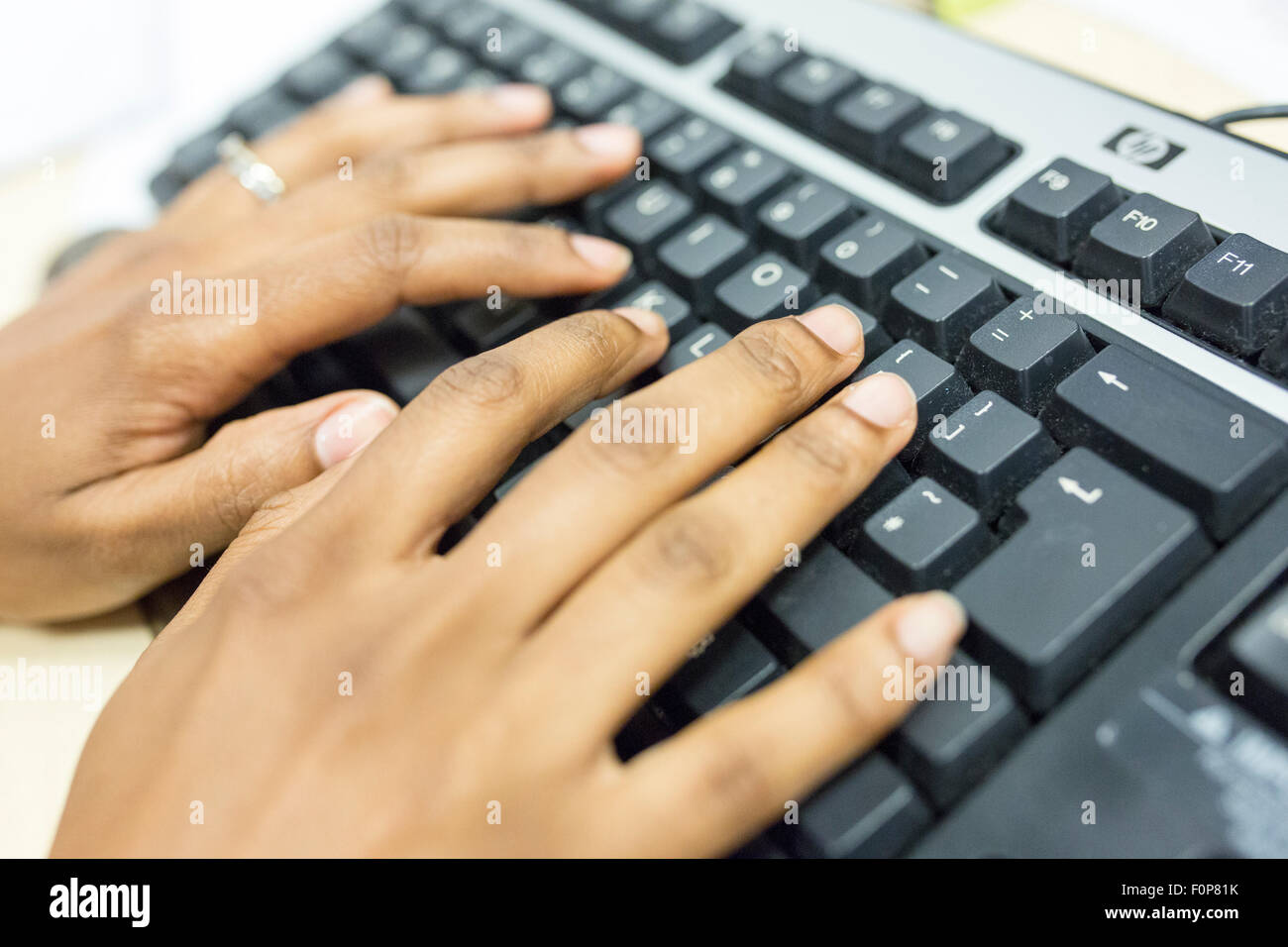 hands on a computer keyboard - Stock Image