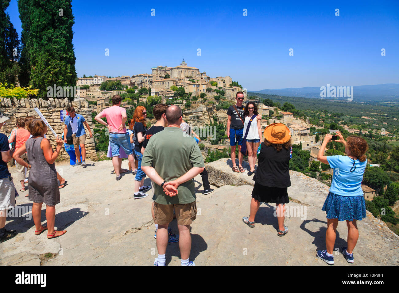 Tourists at the viewpoint of the hilltop village of Gourdes in Provence France - Stock Image