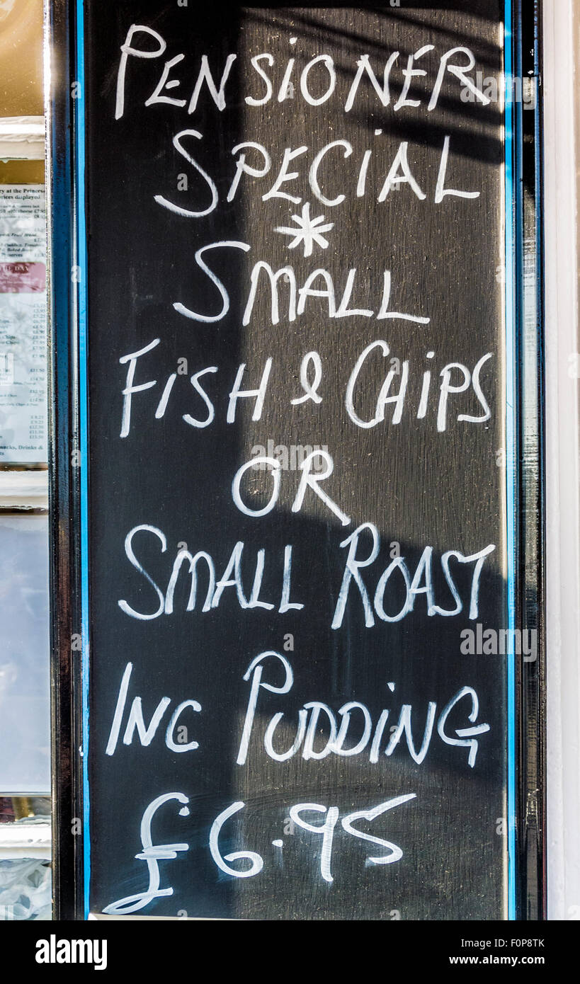 Pensioners Special meal deal sign outside seaside cafe - Stock Image