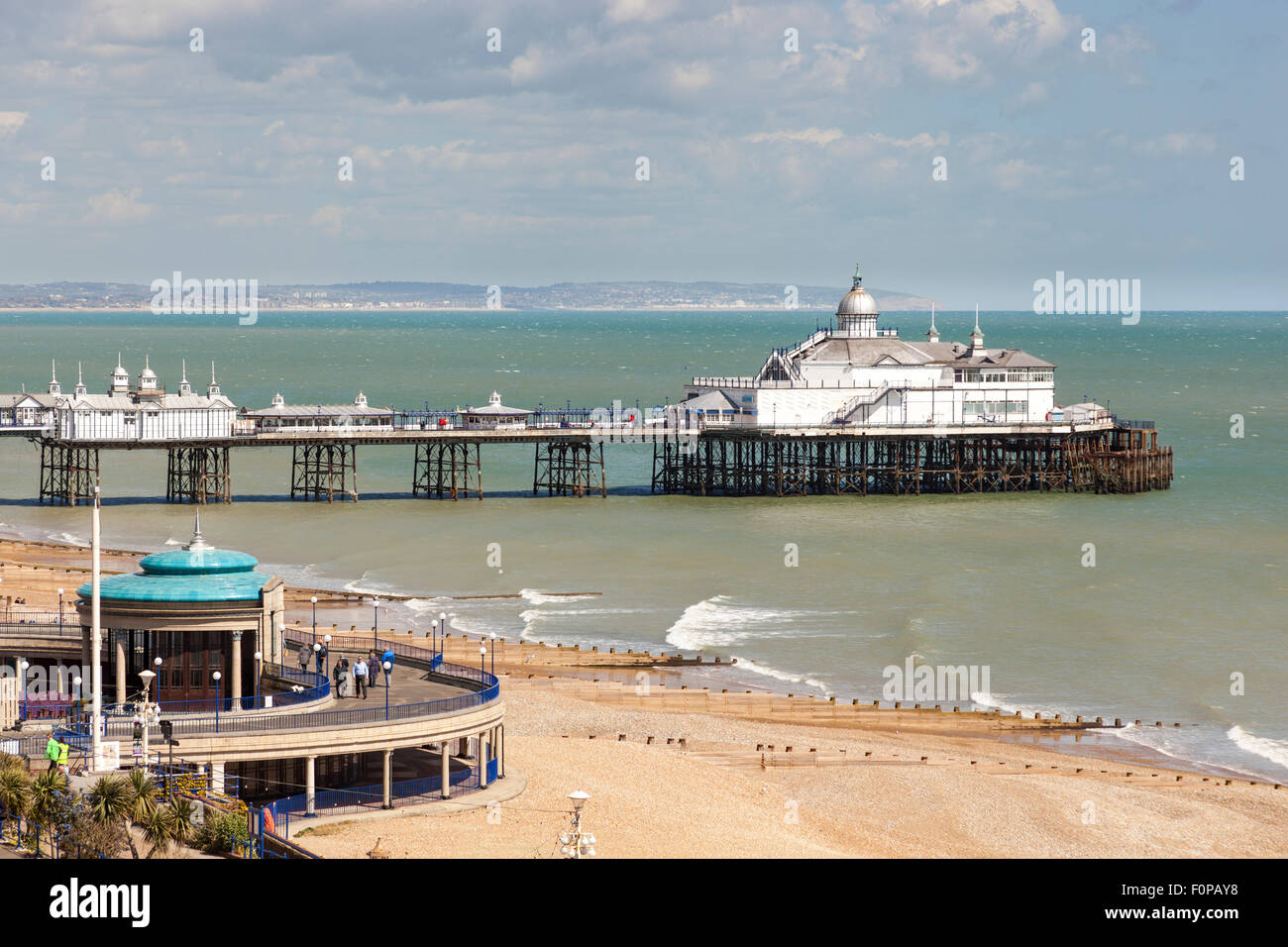The bandstand, pier and beach, Eastbourne, East Sussex, England - Stock Image