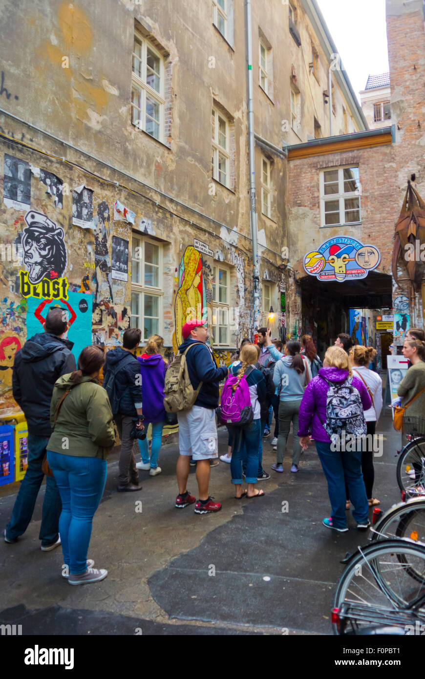 Guided tour group, courtyard of Haus Schwarzenberg, Mitte, Berlin, Germany - Stock Image