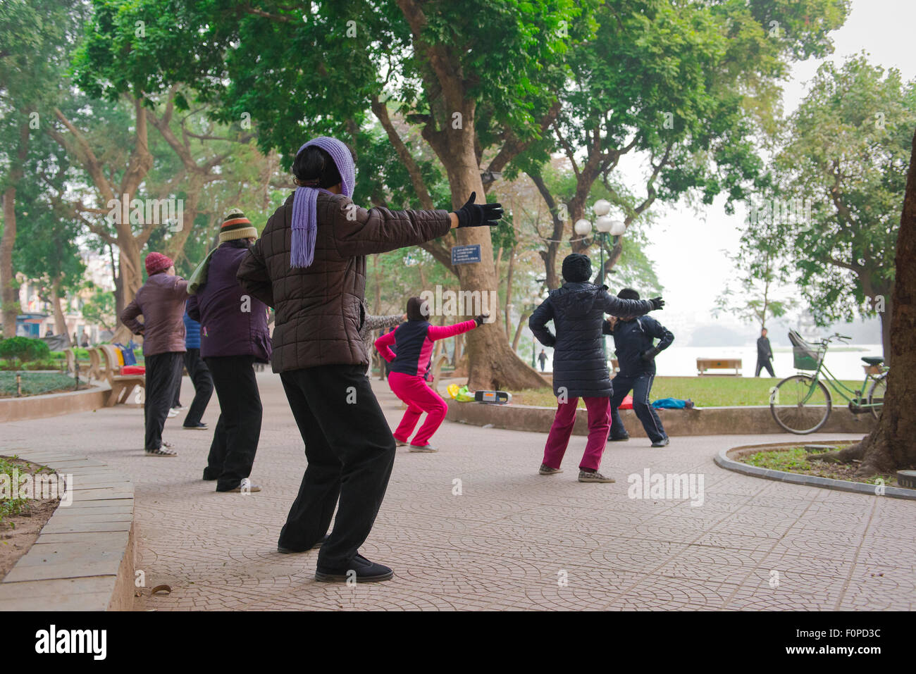 Hanoi tai chi, a group of middle aged women participate in an early morning tai chi session near Hoan Kiem Lake - Stock Image