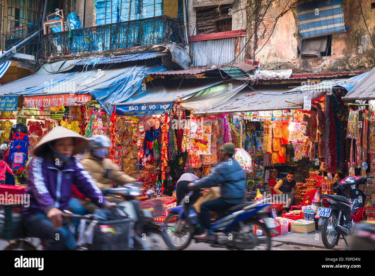 Vietnam street scene, view of traffic in a busy street in the historic Old Quarter of Hanoi, Vietnam. - Stock Image