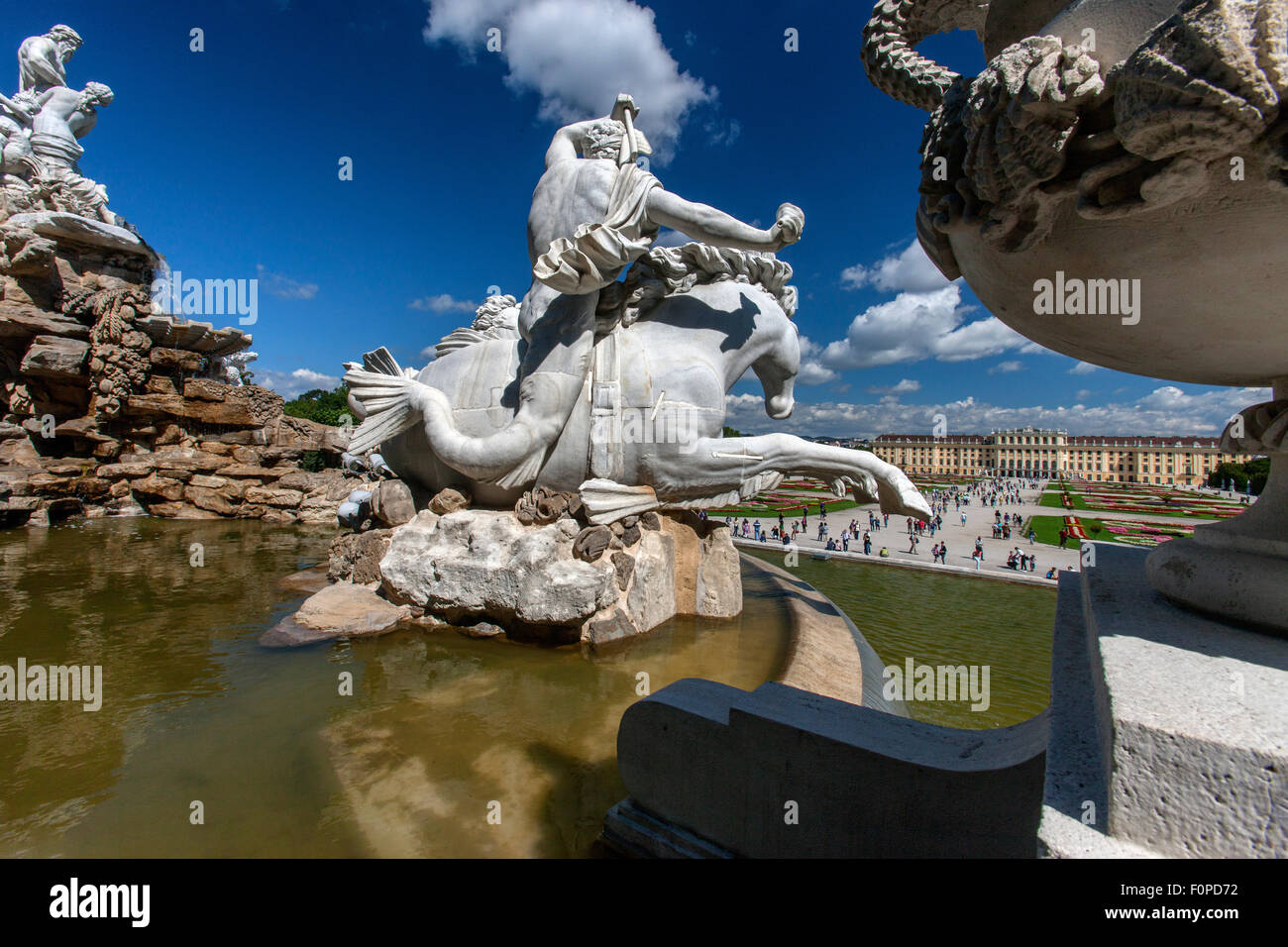 Schoenbrunn Palace and Gardens with Neptun Fountain in foreground, Vienna, Austria - Stock Image