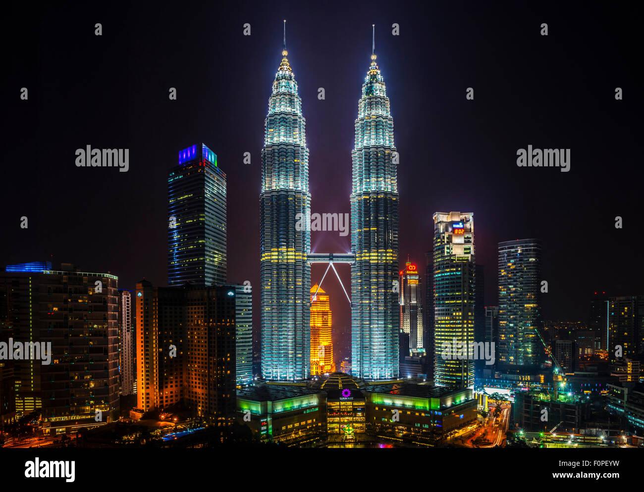 Petronas Towers, Kuala Lumpur, Malaysia at night - Stock Image