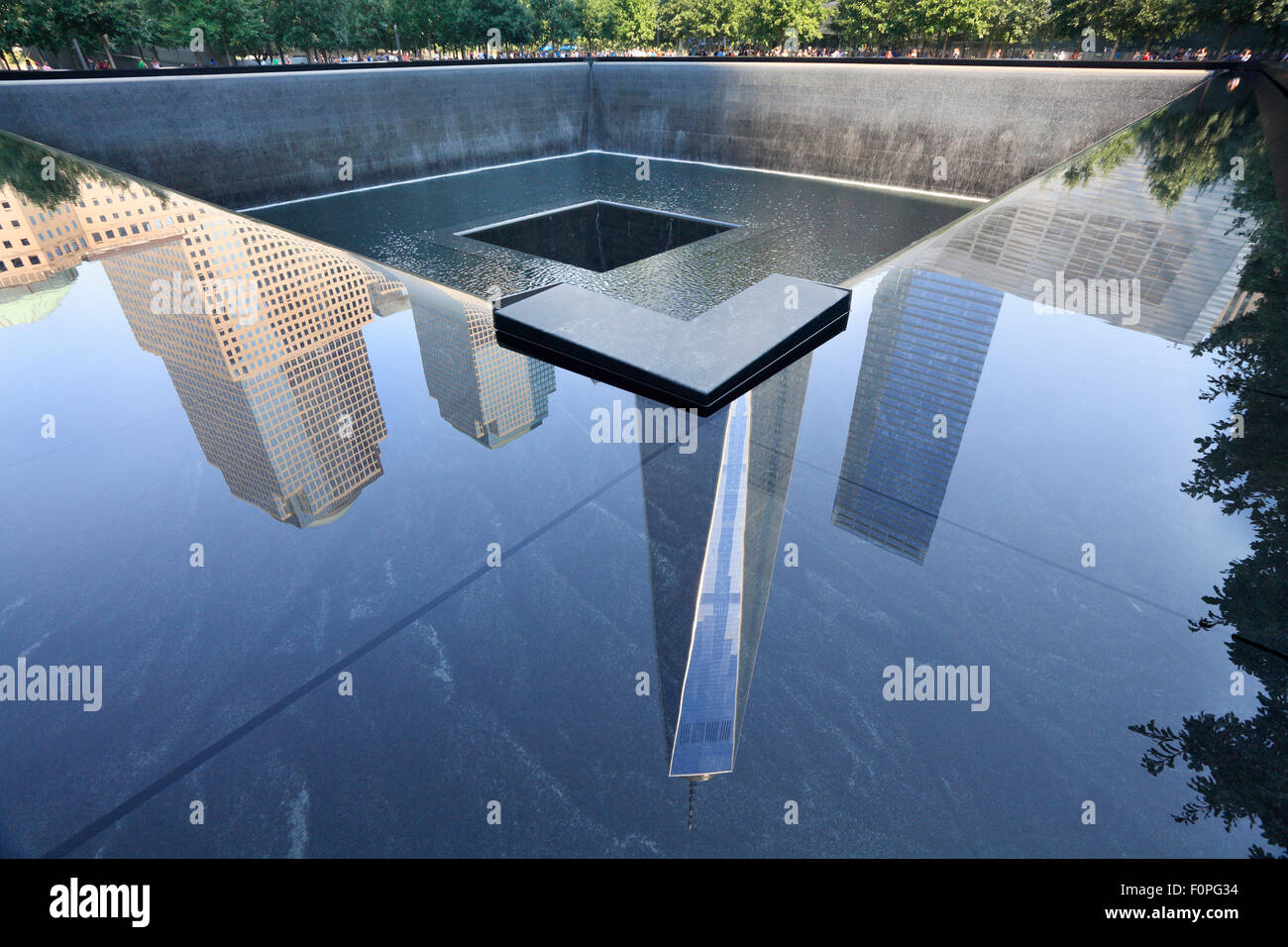 Memorial Fountain and reflections of One World Trade Center on foreground in New York City - Stock Image