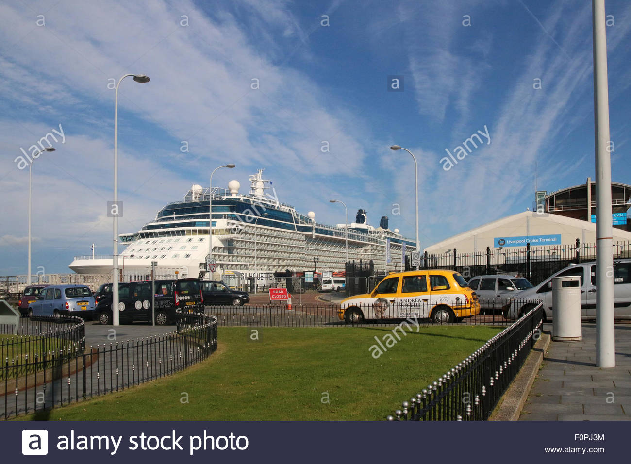 Liverpool, UK 19th August 2015. Against the vivid blue sky the sun shines on the cruise boat moored at the Liverpool - Stock Image
