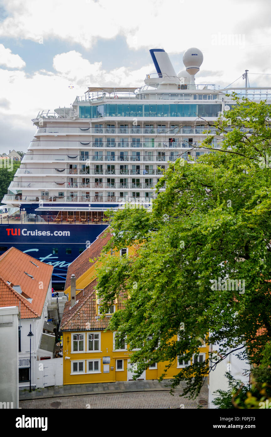TUI cruise ship Mein Schiff in port of Stavanger, Norway and traditional wood paneled houses. - Stock Image