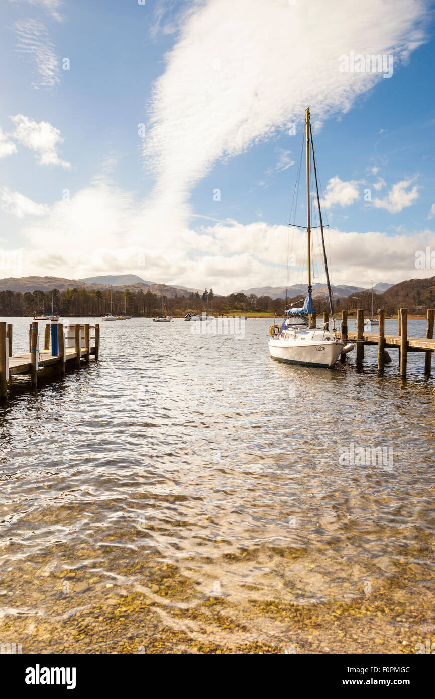 Yacht moored at a jetty, Lake Windermere, Ambleside, Lake District, Cumbria, England - Stock Image