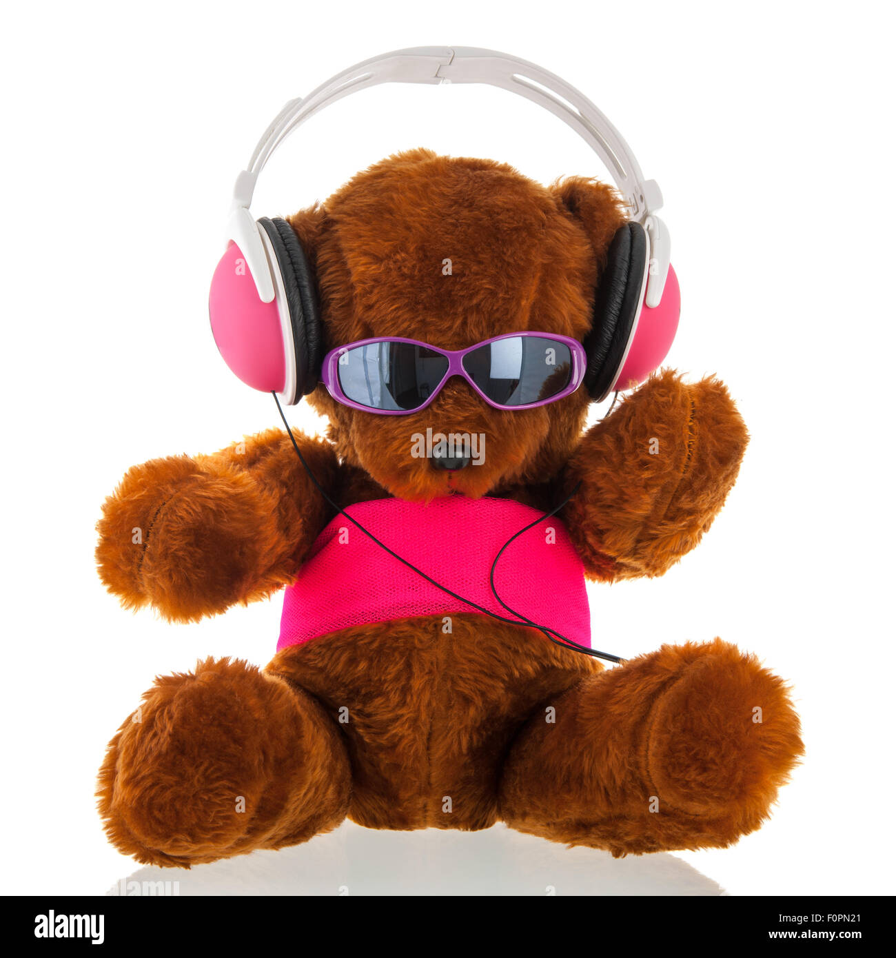 3bd8b93a335 Funny stuffed bear with head phone isolated over white background - Stock  Image