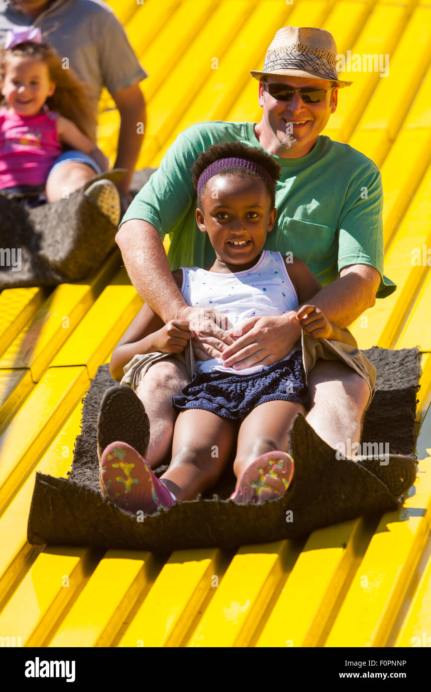 People enjoy a ride down the Giant Slide at the Ohio State Fair in Columbus, Ohio. - Stock Image