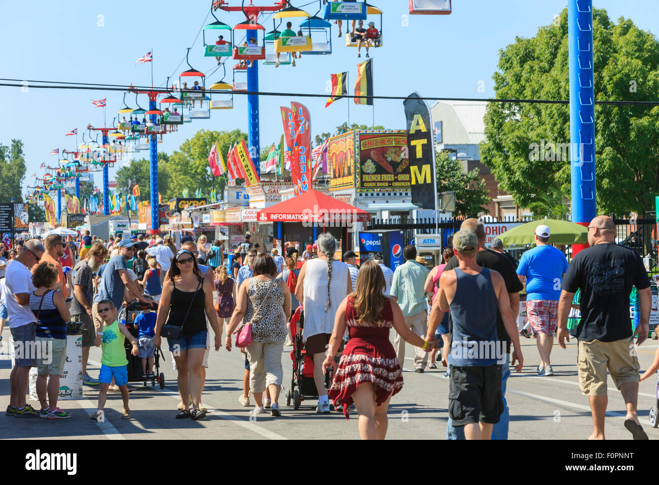 A large crowd walks on the midway at the Ohio State Fair in Columbus, Ohio. - Stock Image