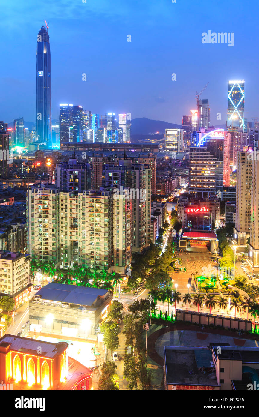 Shenzhen, China - August 19,2015: Shenzhen skyline at twilight with the tallest building of the city on background - Stock Image