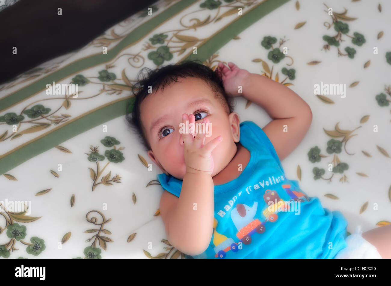 Close up portraits of a cute beautiful bengali baby boy in different moods with copy space