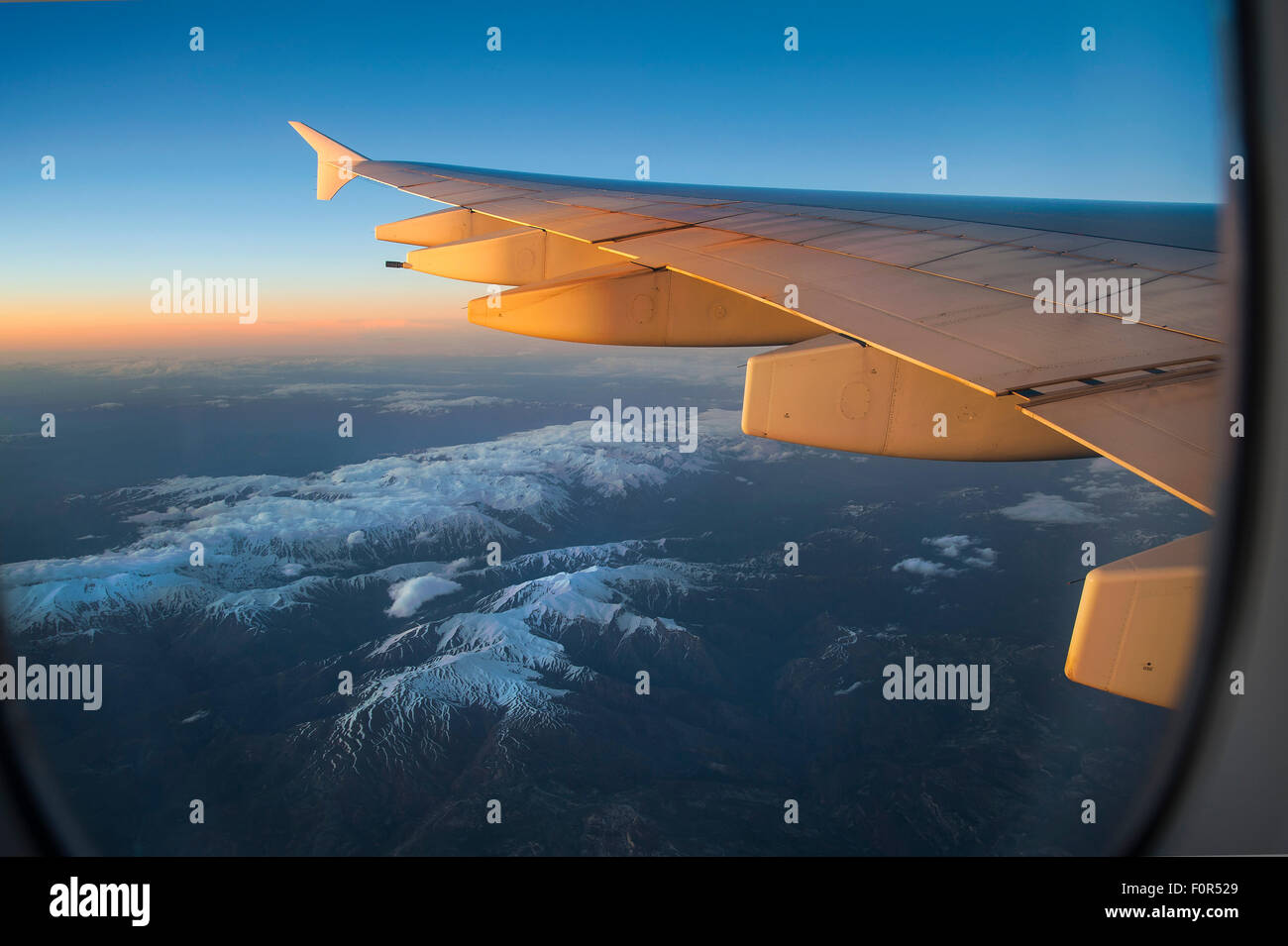 Wing of an Airbus A380-800 over snowy mountains, Balkan Mountains - Stock Image
