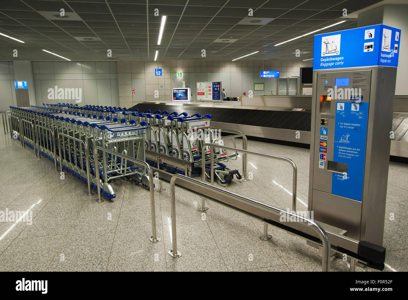 Baggage trolleys and machine, airport, Frankfurt, Hesse, Germany - Stock Image