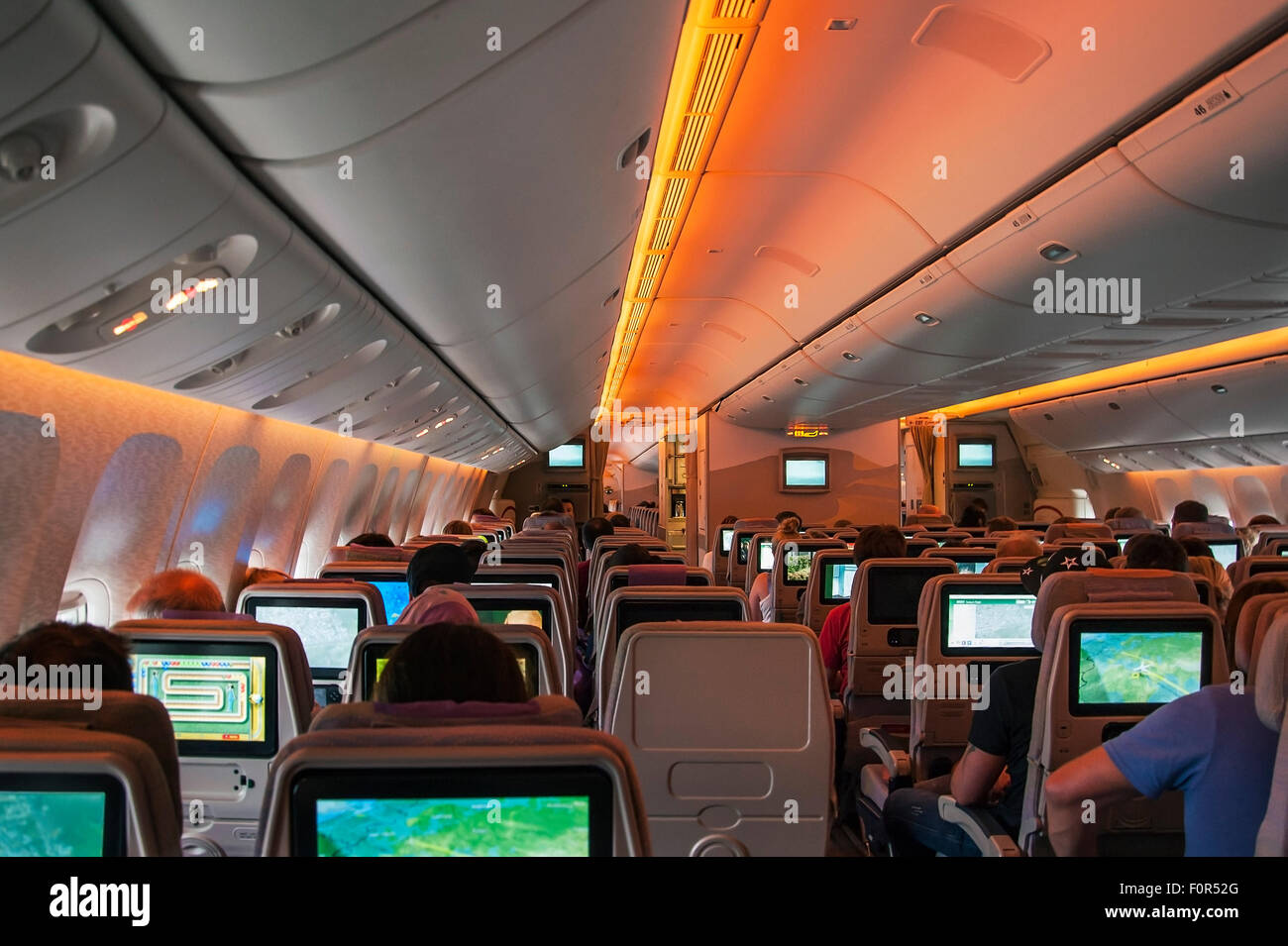 Boeing 777-300 passenger compartment economy class during flight Dubai-Frankfurt - Stock Image