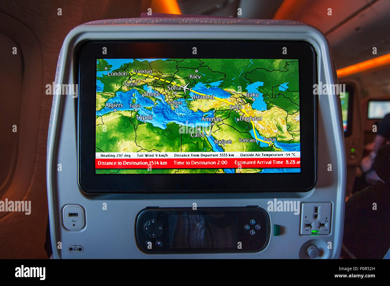 Boeing 777-300, entertainment system, screen in the passenger compartment, economy class, Dubai-Frankfurt - Stock Image