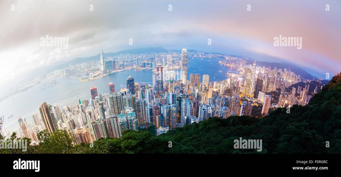 Panoramic day to night transition of Hong Kong - Stock Image
