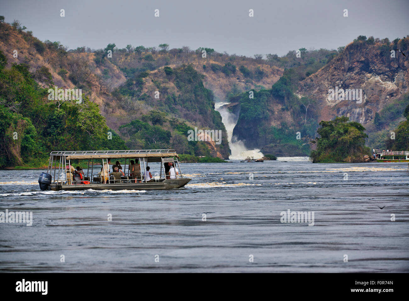 tourist ship on River Nile in front of Murchison Falls, Murchison Falls National Park, Uganda, Africa - Stock Image