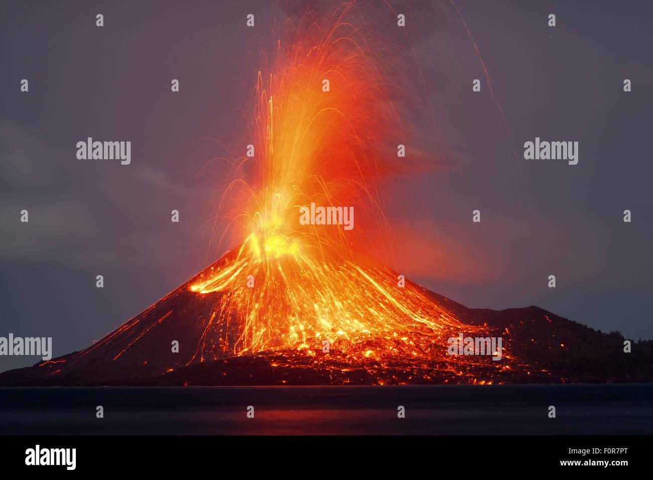 Powerful volcanic night-time eruption from Anak Krakatau volcano, Sunda Strait, Indonesia Stock Photo