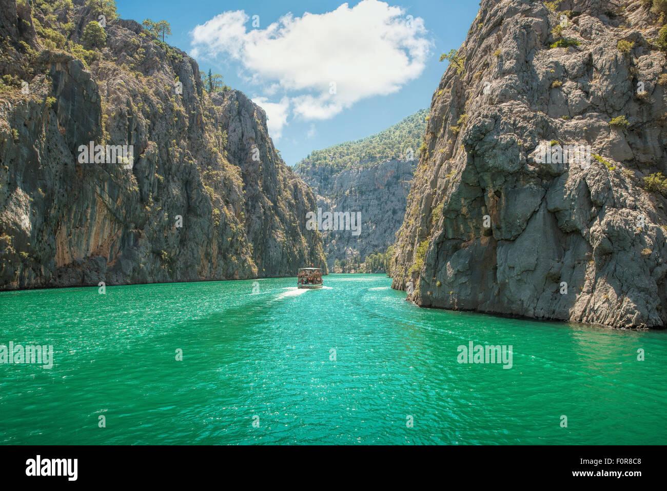 Rocky island green canyon in a mountain lake , Turkey - Stock Image