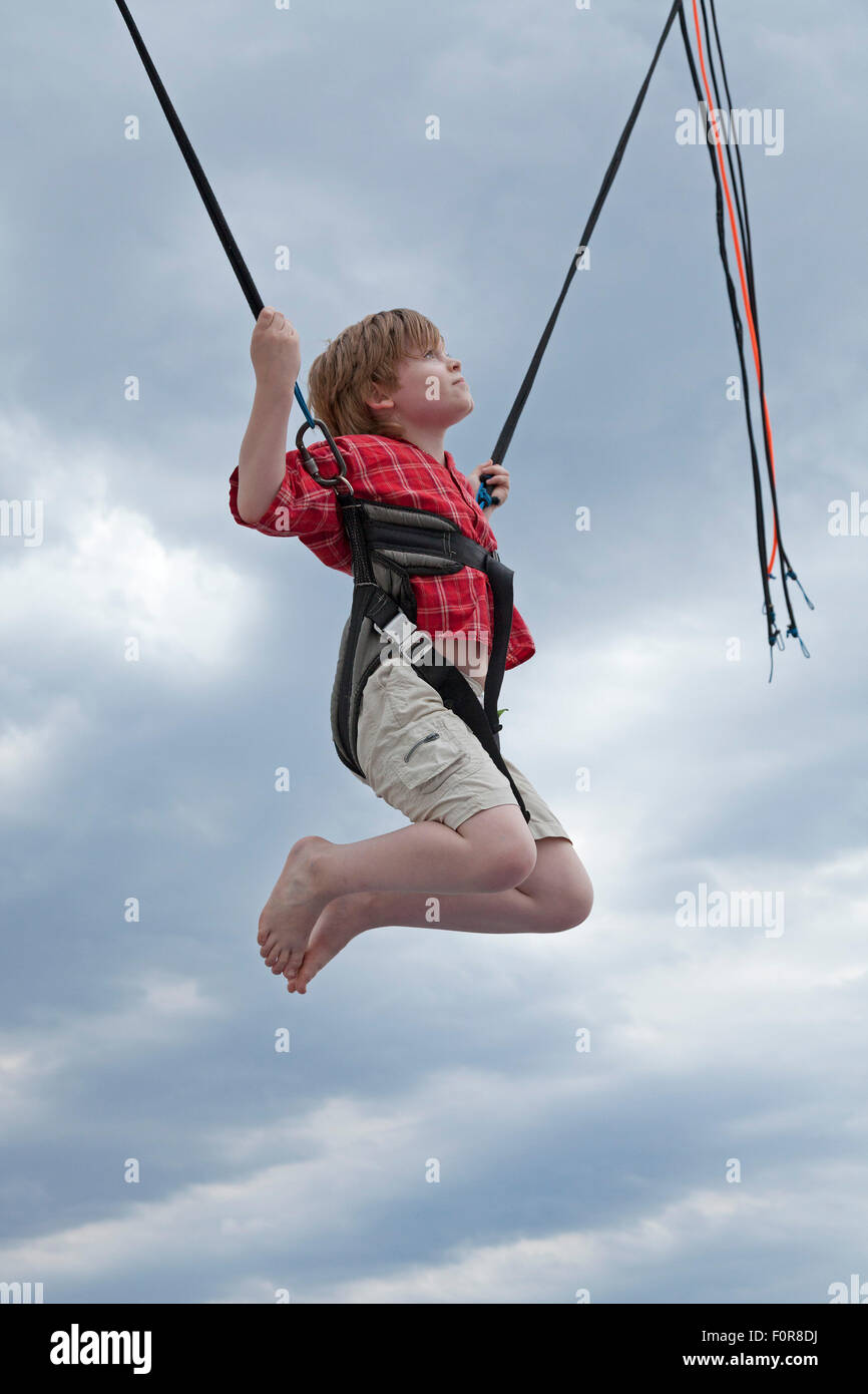 young boy on bungee trampoline warnemuende rostock stock photo 86563390 alamy. Black Bedroom Furniture Sets. Home Design Ideas