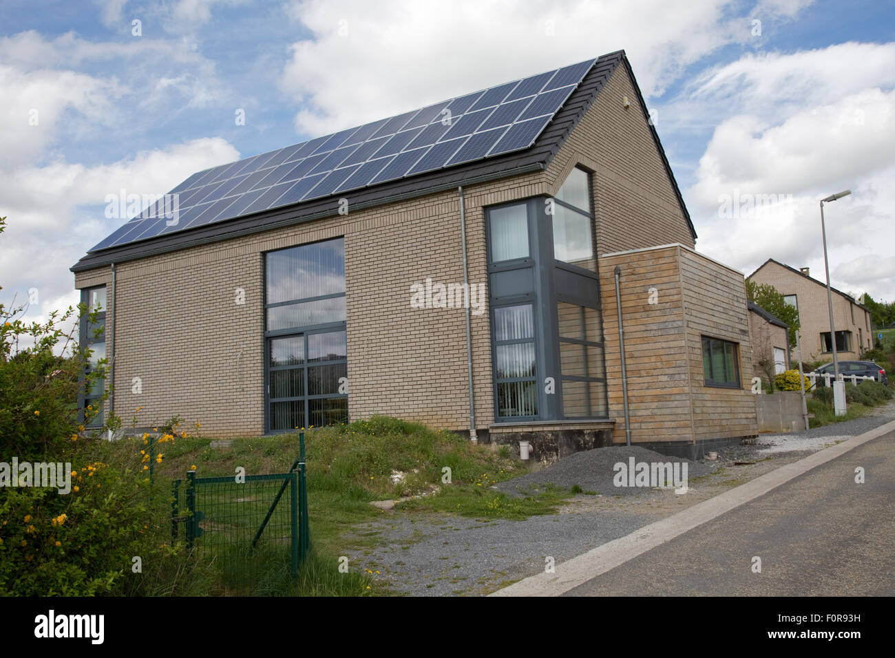 Photovoltaic PV solar panels on roof of domestic house in Germany - Stock Image