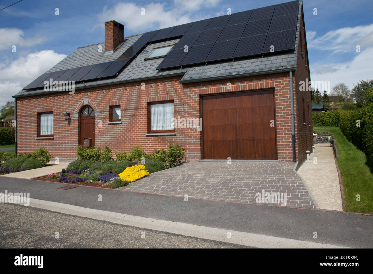 Photovoltaic PV solar panels on roof of domestic house in Germany. - Stock Image