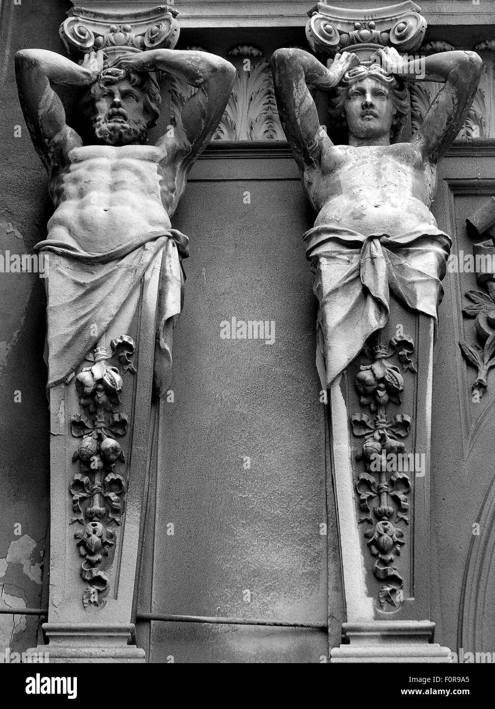 Neo-classical statues above  entrance to the glass-covered arcade in Bucharest, Romania - Stock Image