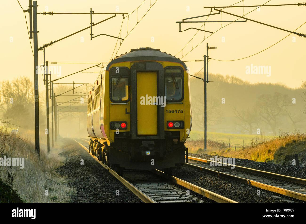 Northern Rail train on the West Coast Main Line near Garstang Lancashire - Stock Image