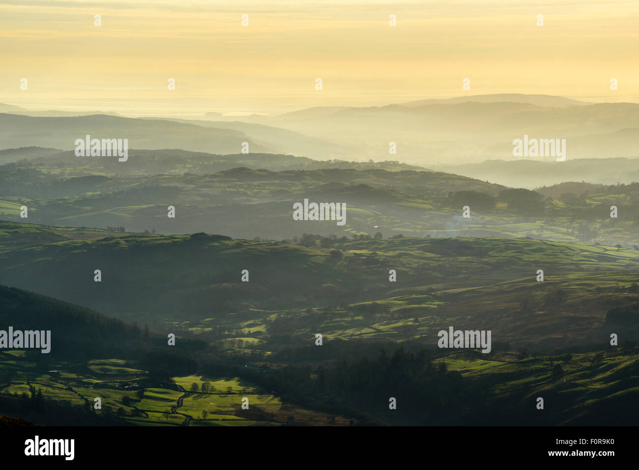 Temperature inversion over southern Lake District from slopes of Kentmere Pike. Distant Morecambe Bay with Heysham - Stock Image