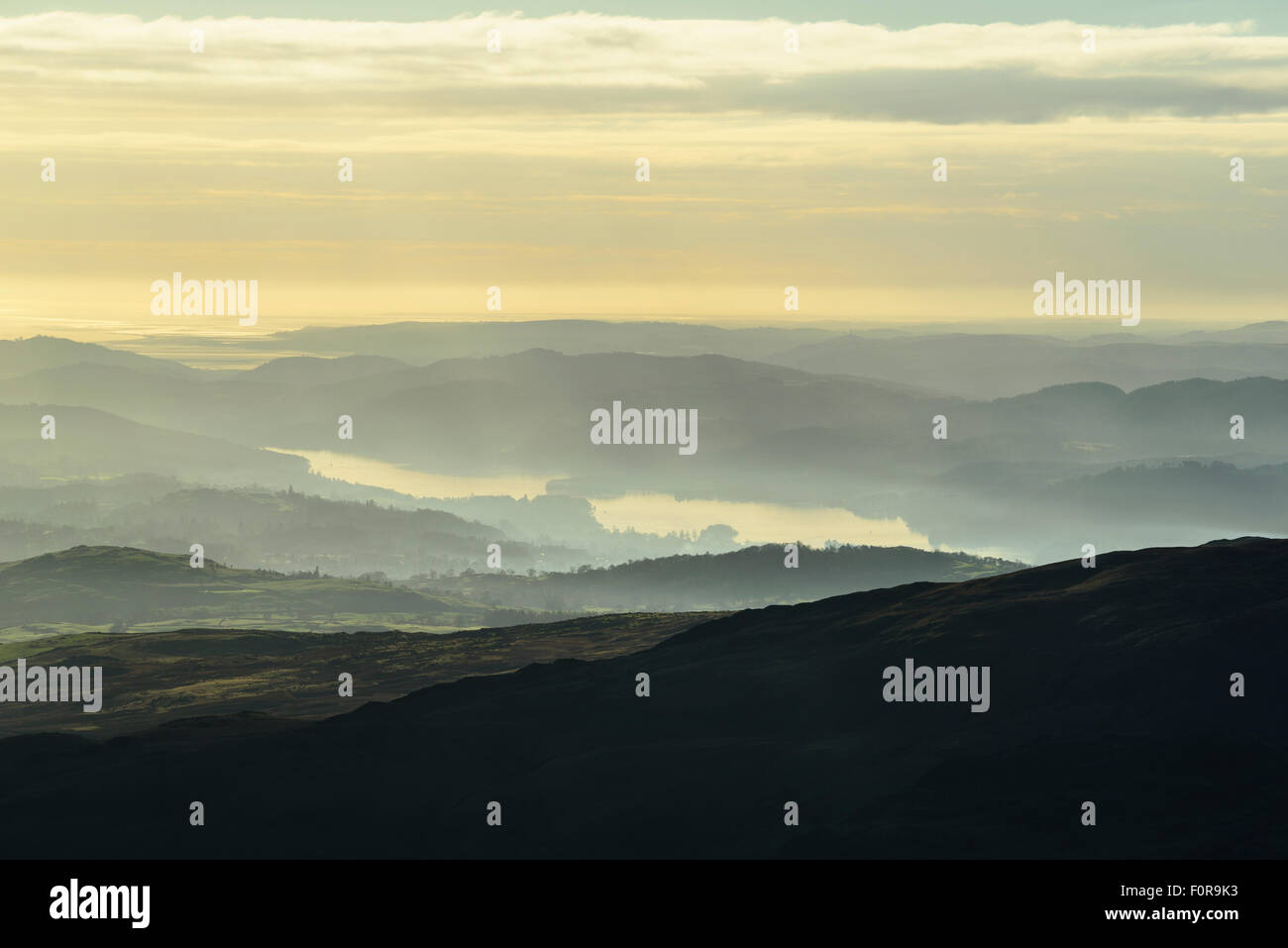 Temperature inversion over southern stretch of Windermere in the Lake District from slopes of Kentmere Pike. - Stock Image