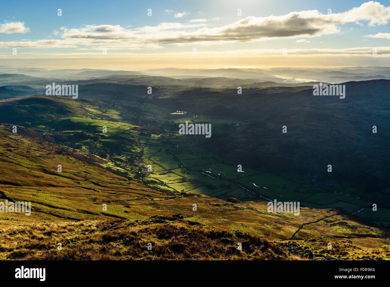 Temperature inversion over Kentmere valley Lake District from slopes of Kentmere Pike with a glimpse of Windermere. - Stock Image