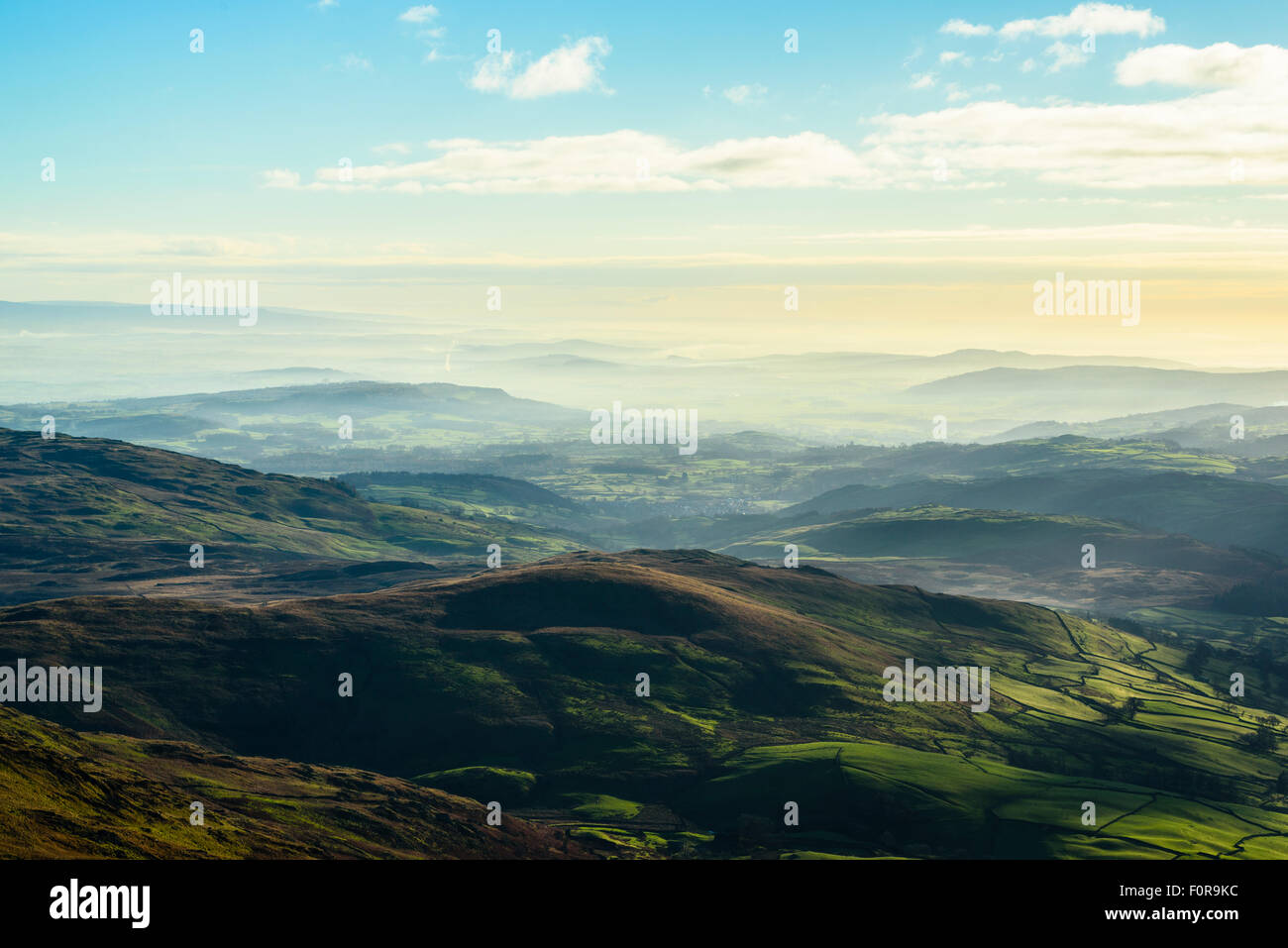 Temperature inversion over southern Lake District and Cumbria from slopes of Kentmere Pike. - Stock Image